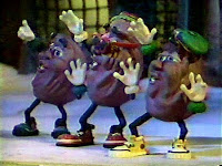 "California Raisins sing ""Rudolph the Red-Nosed Reindeer"" in Claymation Christmas."