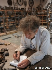Bob Dylan working in his sculpture studio.