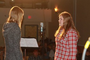Students Alyssa and Morgan from Fosston High School perform a song during the Dec. 14, 2013 Great Northern Radio Show in Fosston, Minnesota. PHOTO: Shelly Hanson