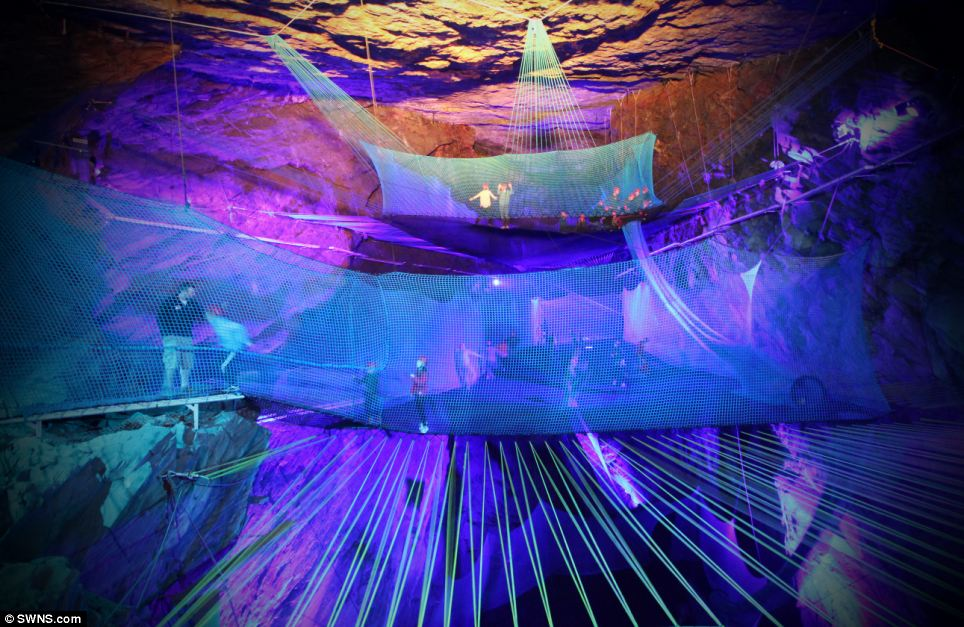 This attraction in an old Welsh slate mine has visitors slide down into an underground mine shaft and jump on trampolines amid colorful light displays. PHOTO: SWNS via Daily Mail.
