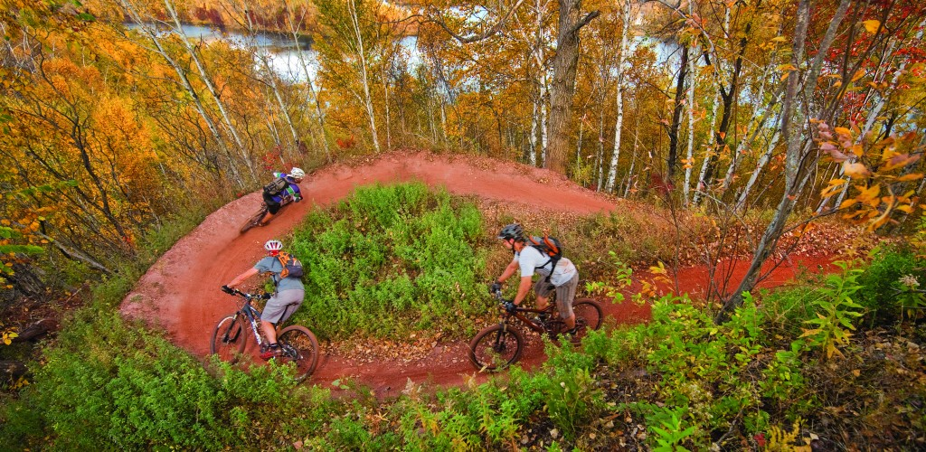 Mining activity ended on Minnesota's Cuyuna Iron Range more than 50 years ago. Now completely reclaimed, old mining dumps have become an international mountain biking hotspot. Talk of scram mining the dumps is raising concern for the new tourism economy. PHOTO: Aaron Hautala for VisitBrainerd.org