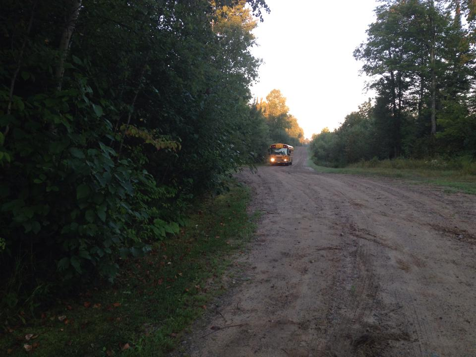 A school bus winds down a long country road for the first day of classes in Northern Minnesota on Sept. 2, 2014. (Aaron J. Brown)
