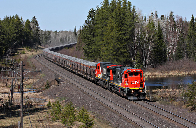 Trains hauling iron ore are an intractable part of the landscape on Minnesota's Iron Range, but delays in hauling other cargo across the Upper Midwest has forced many iron mines to stockpile pellets, waiting for their trains to arrive. (PHOTO: Jerry Huddleston, Creative Commons)
