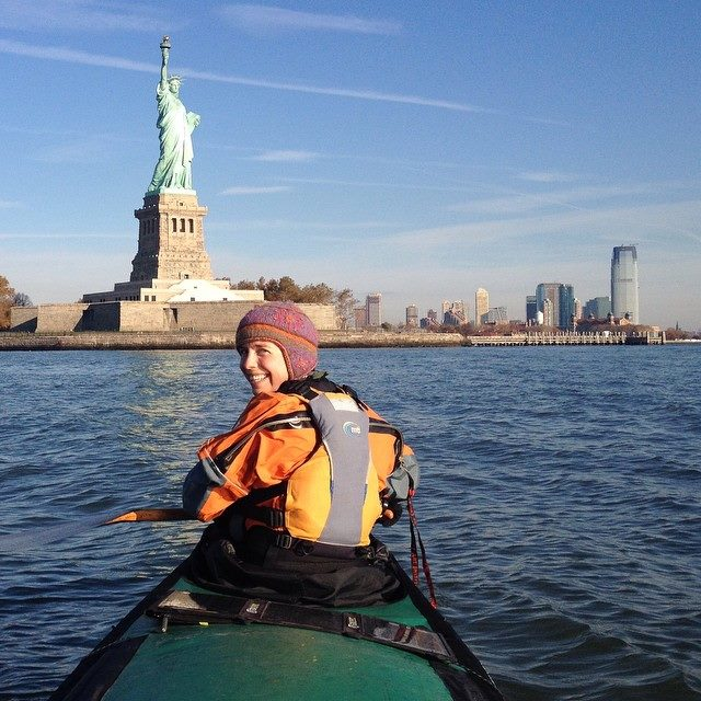 Adventurer Amy Freeman paddles in the shadow of the Statue of Liberty in New York harbor and she and husband Dave made their way to Washington, D.C. (PHOTO: Dave Freeman, Wilderness Classroom)