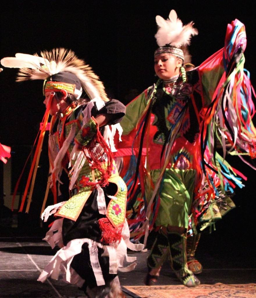 Members of the Northbird Singers, a group of singers, drummers and dancers from the Leech Lake Band of Ojibwa, perform a traditional dance during the Dec. 6, 2014 Great Northern Radio Show at the Northern Lights Casino in Walker, Minnesota.