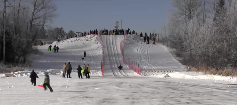 The Laskiainen Sliding Festival in Palo is an annual Finnish mid-winter tradition. (PHOTO: Screenshot from Andrew Krueger YouTube video)
