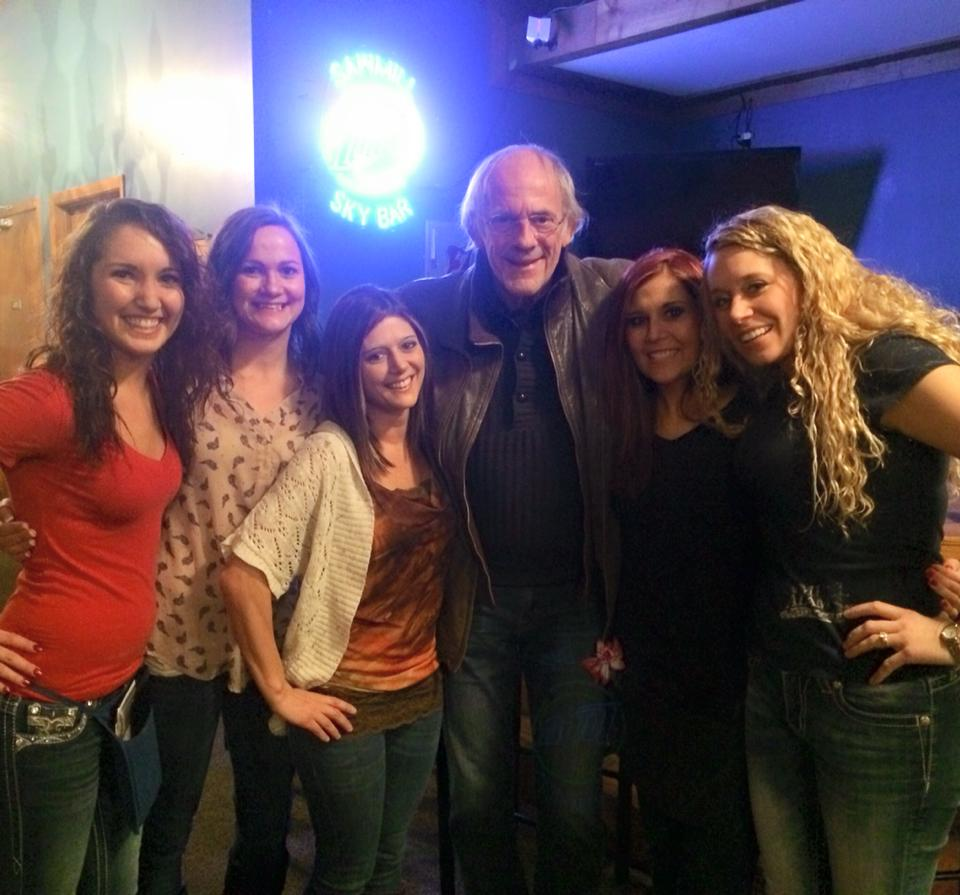 "The actor Christopher Lloyd poses with Sawmill Saloon and Restaurant waitstaff last Thursday, Feb. 26. He was also spotted in Biwabik that night. Lloyd, known for roles on the TV show ""Taxi"" and as the eccentric ""Doc Brown"" in the ""Back to the Future"" movies, is on the Range to film a movie.  (PHOTO: Sawmill Saloon & Restaurant Facebook page)"