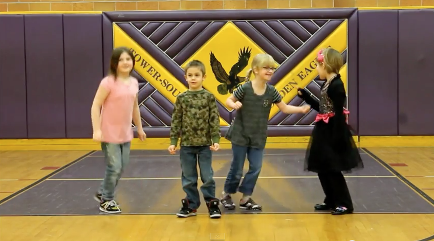 """Kids from Tower-Soudan Elementary dance to """"Happy"""" in this screen shot from a YouTube video."""