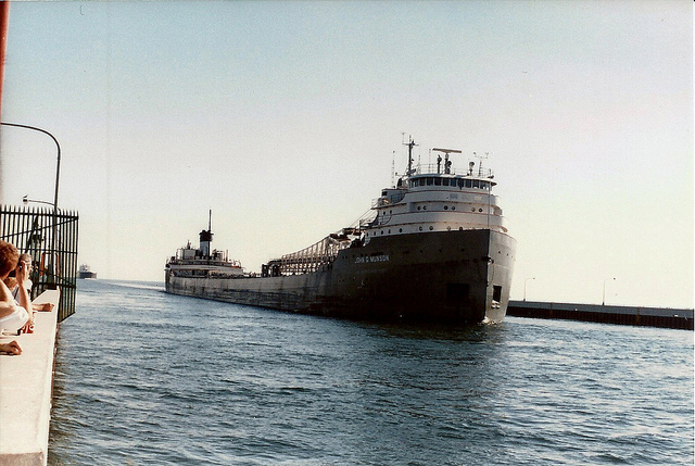 The John G. Munson was built in 1952 at Manitowoc, Wisconsin. She was lengthened 120 feet in the spring of 1976 at the Fraser Shipyards in Superior, Wisconsin and is now 768 feet long. She has 22 hatches on her deck that open into 7 cargo holds. Her maximum carrying capacity is 25,900 tons. She has one of the best steam whistles on the Great Lakes. (PHOTO: Steve Moses, Flickr CC)