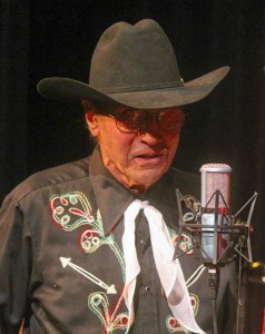 Howard Pitzen performs cowboy poetry during the Dec. 15, 2012 Great Northern Radio Show in Bigfork, Minnesota. Pitzen died April 2 at his home across from the grounds of the Effie Rodeo, which he founded and ran for 60 years. (PHOTO: Shelly Hanson)