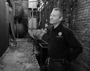 "Dave Aho, owner of Mitchell Yard, standing in the Boiler Room for the documentary ""Last Call for the Mitchell Yards."""