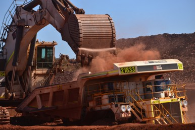 A shovel loads a haul truck at the Roy Hill Mine in western Australia, which will soon put 45 million annual tons of iron ore into the global market. (PHOTO: RoyHill.com.au)