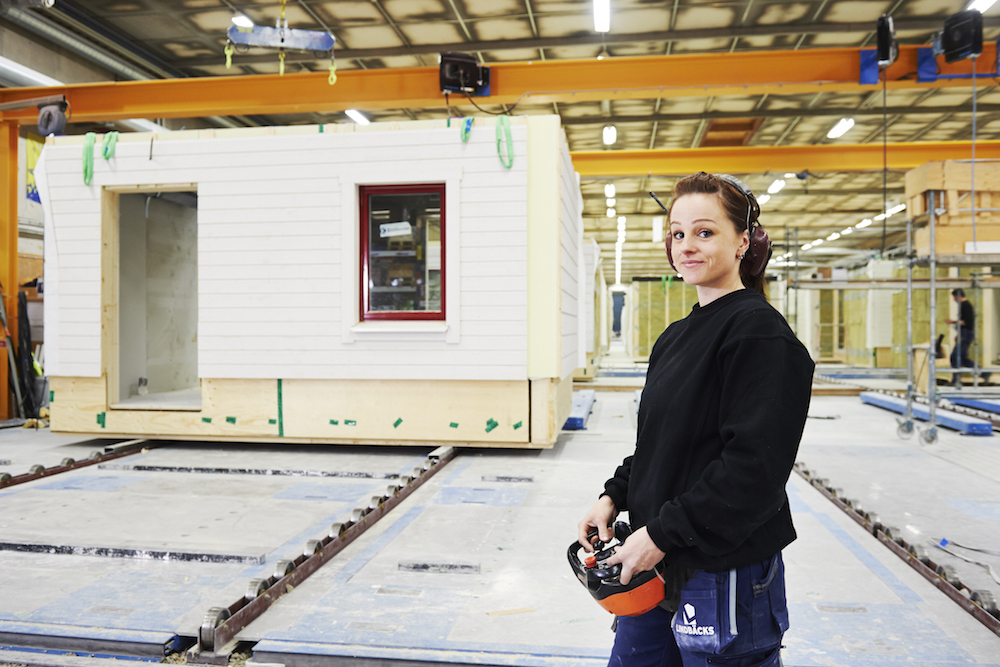 A worker in the Lindbäcks plant in Piteå, Sweden, where modular apartment buildings are built from local lumber and sold in the nation's largest city of Stockholm. PHOTO: Maria Fäldt for Lindbäcks.