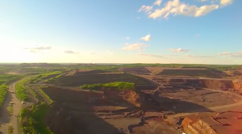 The view from a YouTube video of a drone flight over the east pit at MinnTac near the Iron Range city of Mountain Iron. (screenshot, SquatchAttack)