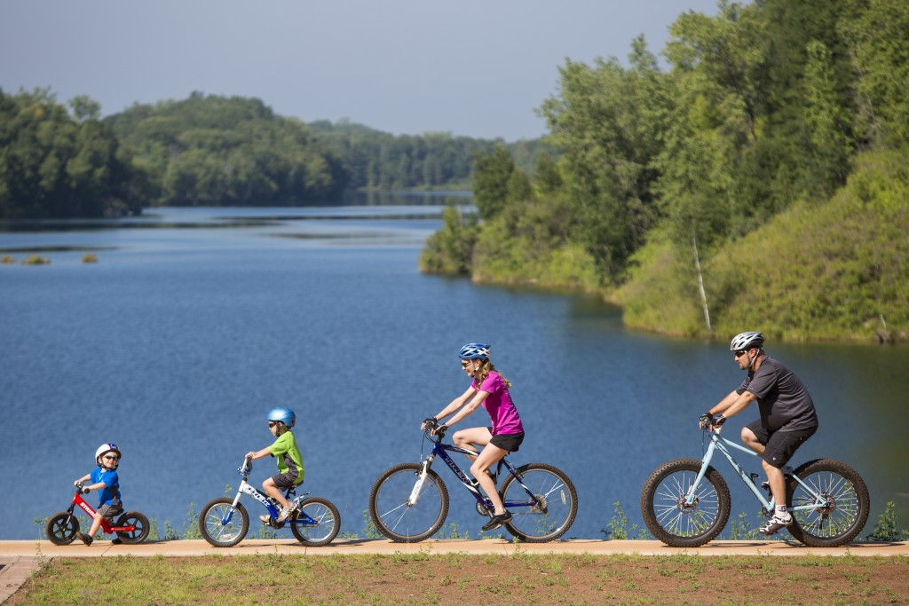 A family rides on the trails of the Cuyuna Country State Recreational Area near Crosby, Minnesota on the Cuyuna Iron Range. Organizers there are trying to build a sustainable economy based on the attractiveness of outdoor recreation. (PHOTO: Aaron Hautala)