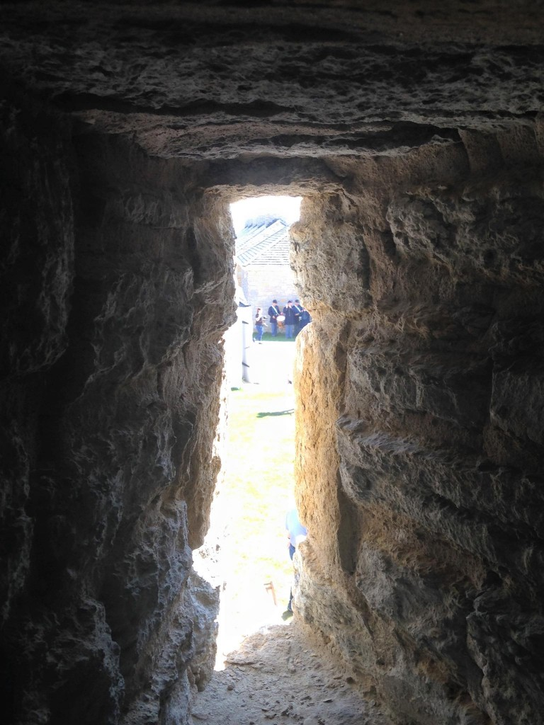 The drum and fife band as seen through the narrow gun slots of the old Round Tower at Fort Snelling in St. Paul on Aug. 15, 2015. (Aaron J. Brown)