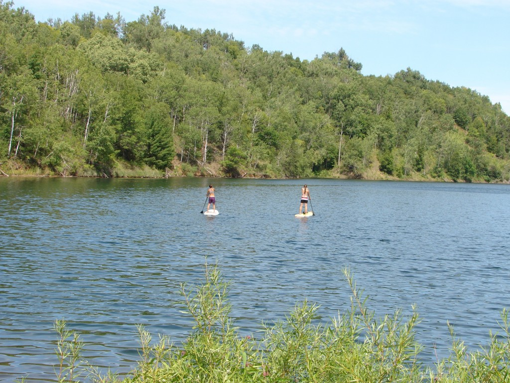 Paddle boarders navigate the Pennington Pit at the Cuyuna State Recreational Area near the twin towns of Crosby and Ironton, Minnesota. I wrote about the Cuyuna Range's success in building a different concept for a local economy last year. (Aaron J. Brown)