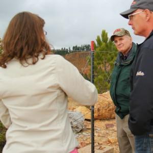 Gov. Dayton listens to a presentation at Gilt Edge Mine in South Dakota on Oct. 27, 2015.