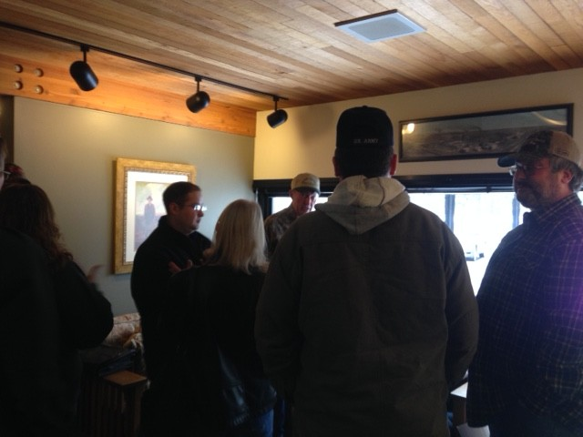 Rural Itasca County residents gather to celebrate after the IRRRB vote on Monday, Dec. 21. (Aaron J. Brown)