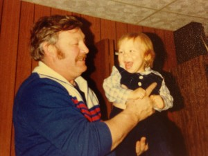 Marvin Johnson holds his grandson, the author of this blog, on Christmas, 1980.