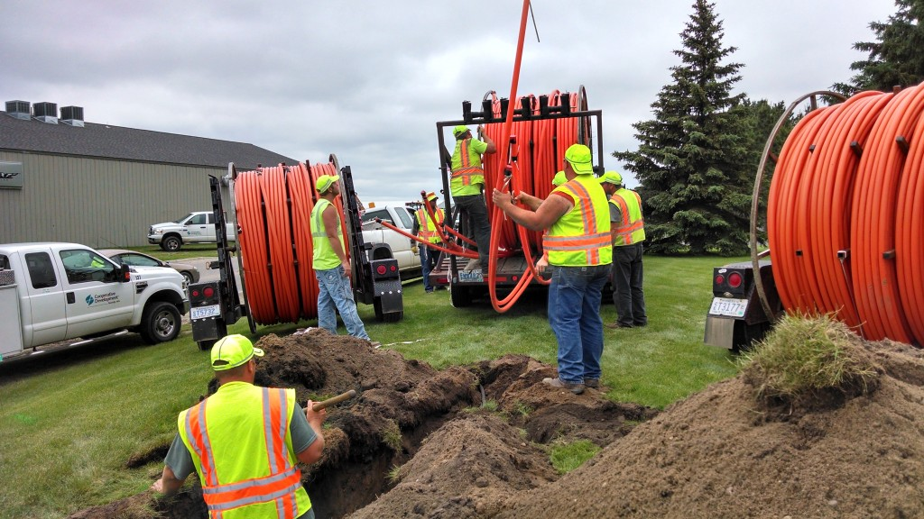 Workers install high speed fiber optic cables for a 2015 Paul Bunyan Communication project. (PHOTO: Paul Bunyan Communication)