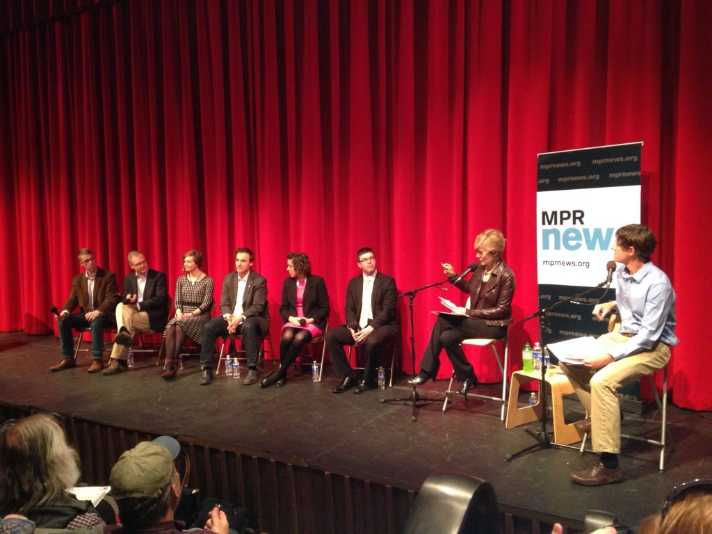 Panelists Brendan Jordan, Rolf Weberg, Jessalyn Sabin, Sean Wilenz, Anna Anderson and Aaron Hautala interact with co-hosts Cathy Wurzer and Dan Kraker at the April 13, 2016 forum at the HCC Theater in Hibbing.