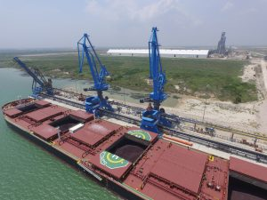 Giant cranes unload Brazilain iron ore from the CASTILLO DE NAVIA in Corpus Christi, Texas. (Voestalpine)