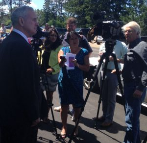 Gov. Mark Dayton speaks to reporters outside the Nashwauk Township Hall on Tuesday, July 12, 2016 after he and the CEO of Cliffs Natural Resources announced a plan to take over the Essar site and build a direct-reduced iron plant. (Aaron J. Brown)