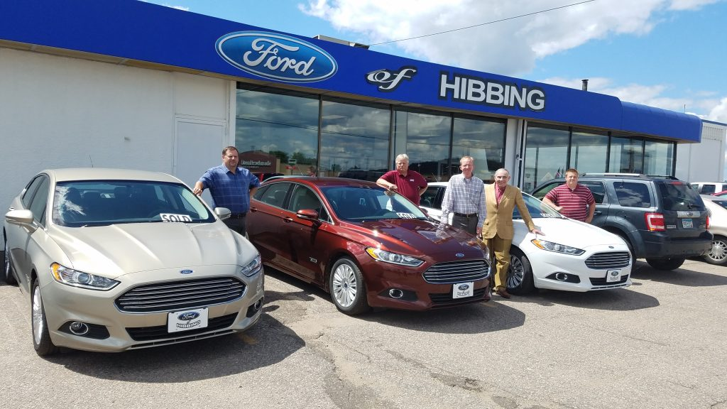 The Voyageurs Council of the Boy Scouts of America take on three new plug-in hybrid vehicles at Ford of Hibbing last month. (Photo submitted)