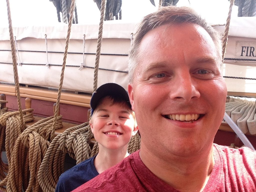 My son Henry and I on deck of the brig Niagara a Duluth Tall Ships 2016.
