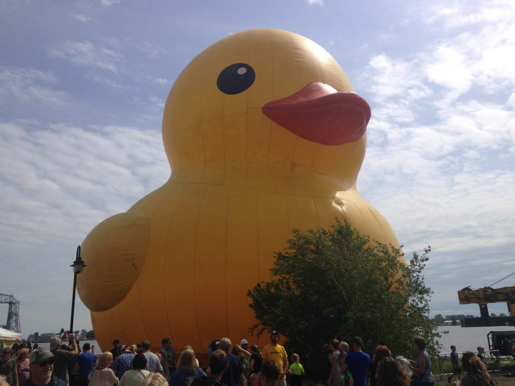 """The """"World's Largest Rubber Duck,"""" a six-story quacker parked in Bayfront Park, is a popular attraction at Tall Ships 2016 in Duluth. (Aaron J. Brown)"""