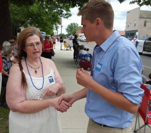 Tom Whiteside interacts with a voter at the Keewatin Fourth of July parade (PHOTO via Whiteside campaign FB page)