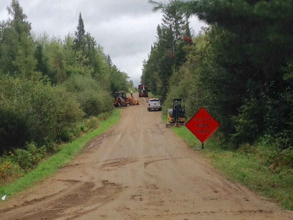 Crews install new Paul Bunyan Communication fiber optic lines on a Balsam Township road this week. This is the road that leads to MinnesotaBrown World Headquarters. (Aaron J. Brown)