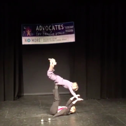 """""""Donald Trump"""" and """"Hillary Clinton"""" won the Third Annual Advocates for Family Peace Lip-Sync Battle on Oct. 29 for their mouthing of the Bill Medley and Jennifer Warnes hit """"Time of My Life"""" from Dirty Dancing. Richie and Donna Johnson of Hibbing performed as the candidates. (Screenshot, FB video)"""